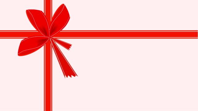 stockvideo's en b-roll-footage met video van roze kaartje met rood lint - birthday gift voucher