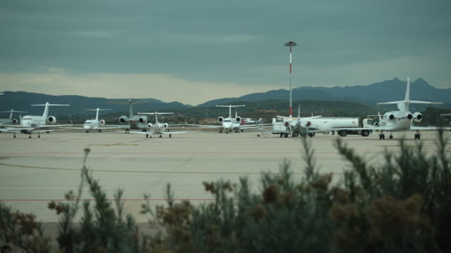 Video of planes parked on an airport runway video
