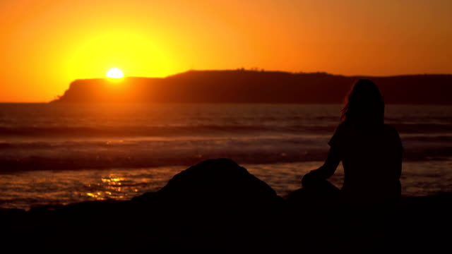 Video of practicing yoga at the sunset in real slow motion video