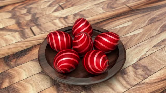 3D video of Red Easter eggs in a wooden plate around which the camera rotates