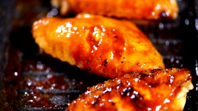 Video of roasting chicken wings in a pan Video of roasting chicken wings in a pan animal wing stock videos & royalty-free footage