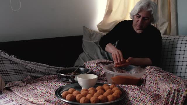 UHD Video Of Senior Woman Preparing Stuffed Meatballs video
