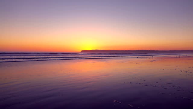 Video of sunset on the beach in real slow motion