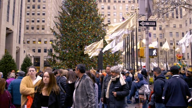 Video of The Christmas Tree in Rockefeller Center With Large Groups Of Tourists