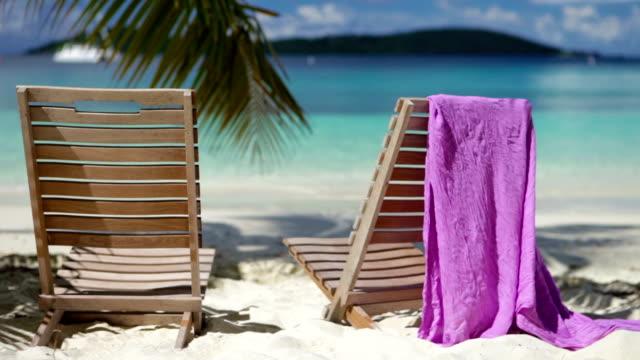 video of two chairs at salomon bay beach, st.john, usvi - sarong bildbanksvideor och videomaterial från bakom kulisserna