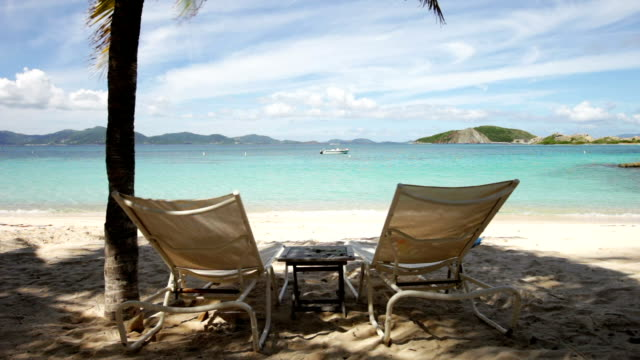 video of two empty beach recliners at Peter Island, BVI video