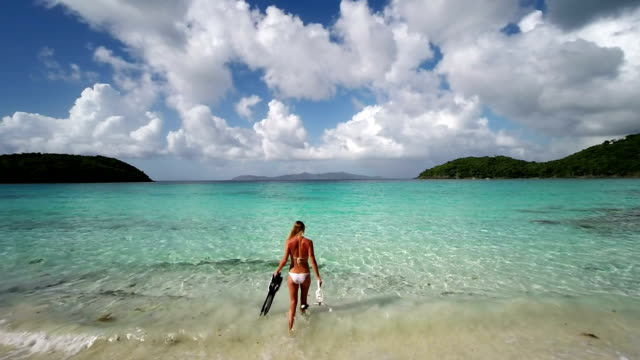 video of unrecognizable woman going snorkeling in the Virgin Islands video
