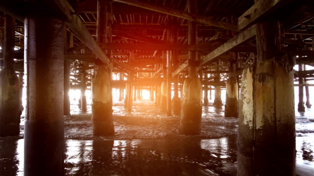 Video of walking under pier in real slow motion video