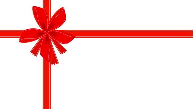 stockvideo's en b-roll-footage met video van witte gift card met rood lint - birthday gift voucher