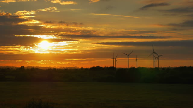 Video of windmills at the sunset in 4K video