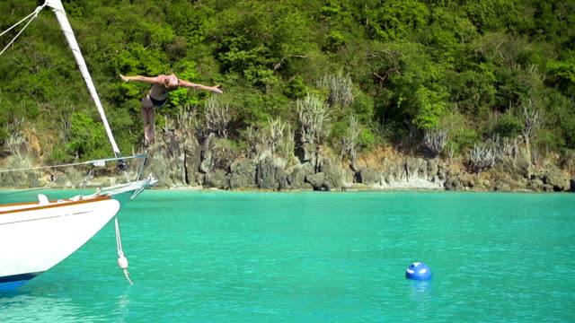 video of woman backfliping from a sailboat in the Caribbean video