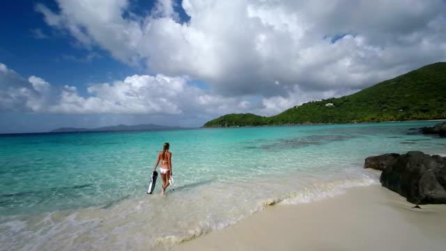 video of woman in bikini going snorkeling in St.John, USVI video