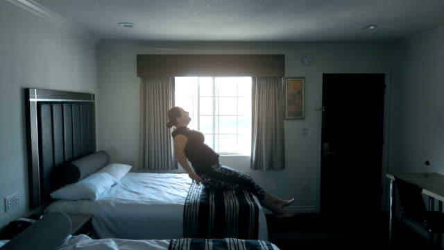 Video of woman jumping on the bed in real slow motion video