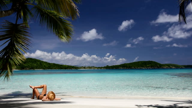 video of woman sunbathing at a beach in St.John, USVI video