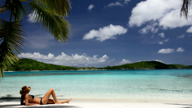 video of woman sunbathing at a beach in St.John, USVI video