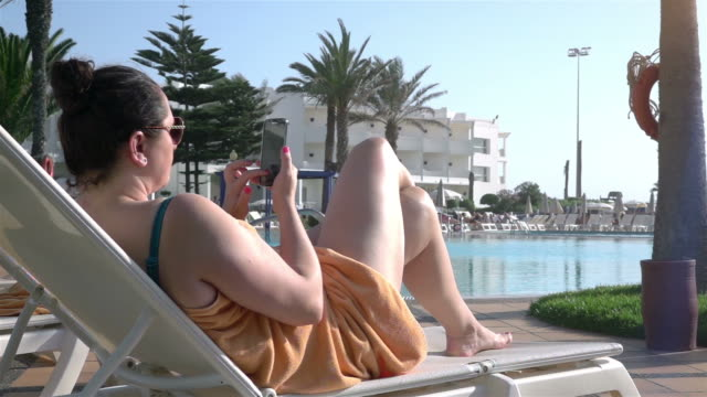 Video of woman using mobile phone in real slow motion video