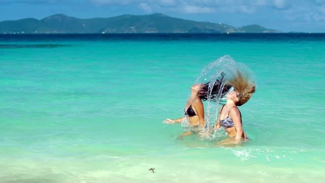 video of women flipping their hair in the Virgin Islands video