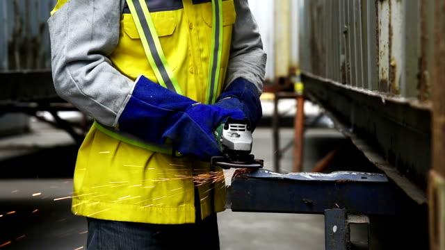 video of worker grinding, grinding steel video