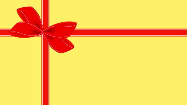 stockvideo's en b-roll-footage met video van gele gift card met rood lint - birthday gift voucher