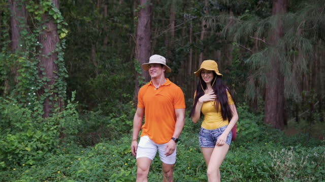 Video of Young Couple traveling in the forest together.