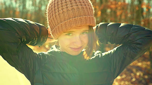 Video portrait of 16-years-old pretty girl walking outdoor at fall video