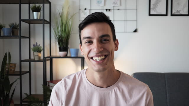 Video portrait of man looking directly into camera - simulating video call
