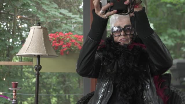 Video Portrait Senior Woman Alone taking Selfie