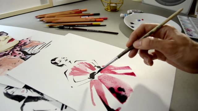 video process of painting fashion sketch rose - индустрия моды стоковые видео и кадры b-roll