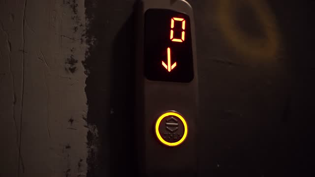 Video recording of a digital counter from ten to zero of a descent of a lith in a building. Modern light, countdown.