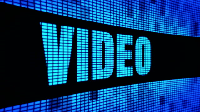 Video Side Text Scrolling LED Wall Pannel Display Sign Board Video Side Text Scrolling on Light Blue Digital LED Display Board Pixel Light Screen Looped Animation 4K Background. Sign Board , Blinking Light, Pixel Monitor . LED Wall Pannel multimedia stock videos & royalty-free footage