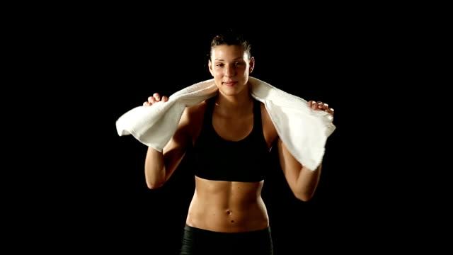 hd video sport girl training dry black background - black woman towel workout bildbanksvideor och videomaterial från bakom kulisserna