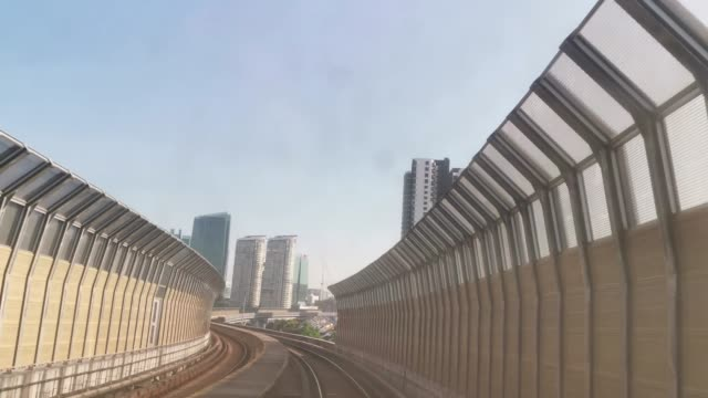 video took on MRT monorail ride in Kuala Lumpur through smart phone during day video took on MRT monorail ride in Kuala Lumpur through smart phone railing stock videos & royalty-free footage