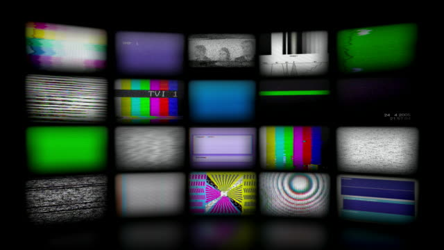 Video Wall Background. (Loopable) Video wall background with many real glitchy coloured TV screens. Seamless loopable and HI resolution. cable tv stock videos & royalty-free footage