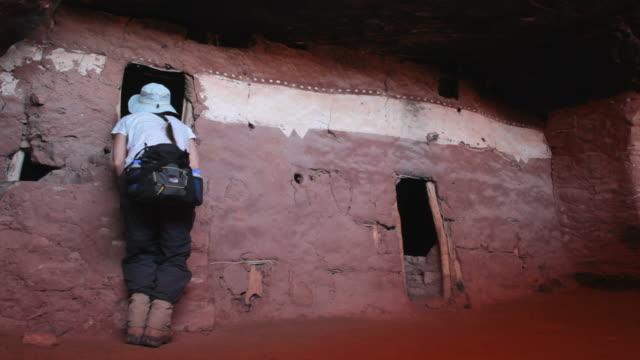 HD video woman explores ancient Pueblo homes Utah video