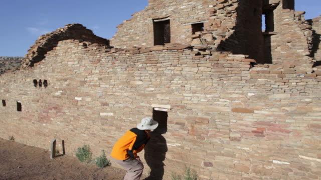 HD video woman explores pueblo ruin Chaco Canyon NHP video