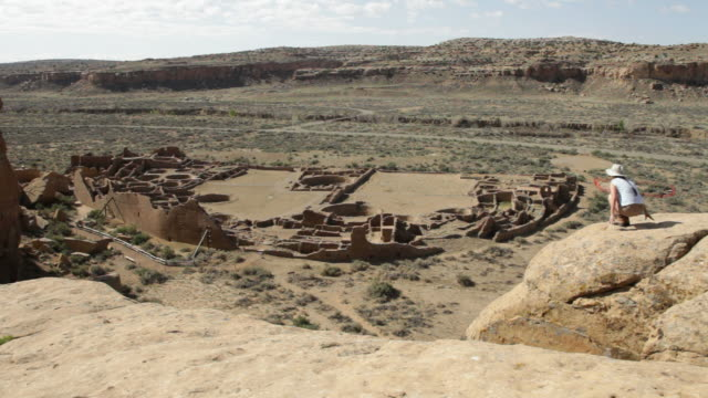 HD video woman hikes overlook in Chaco Canyon NHP video