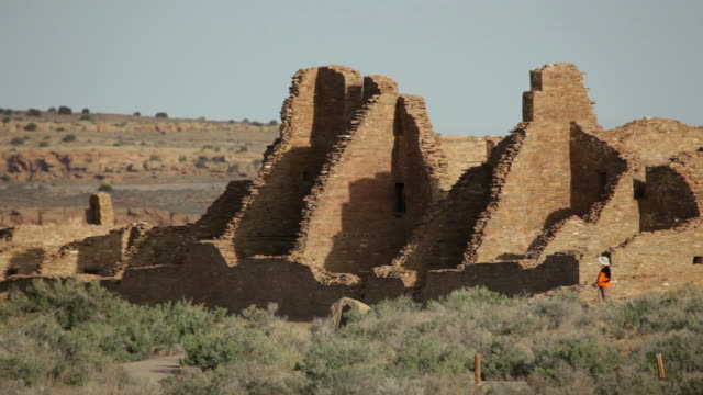 HD video woman looks at pueblo ruin Chaco Canyon NHP video