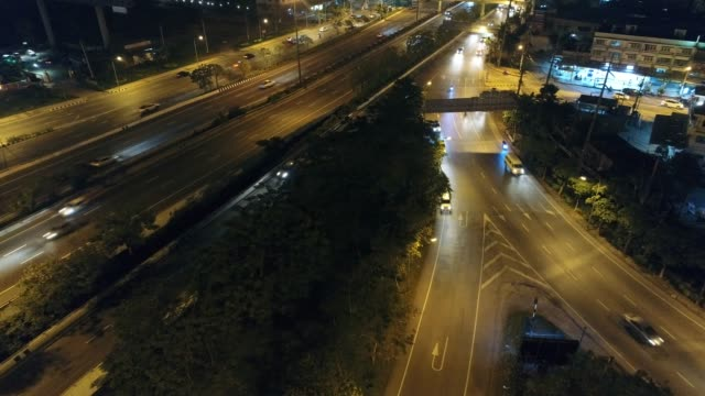 Video,Of traffic on city streets at night. Aerial view and top view of traffic on freeway, 4K.
