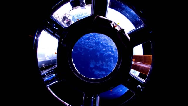 2 videos in1. Planet Earth seen from the ISS. Earth through the porthole of the ISS. Elements of this video furnished by NASA. video