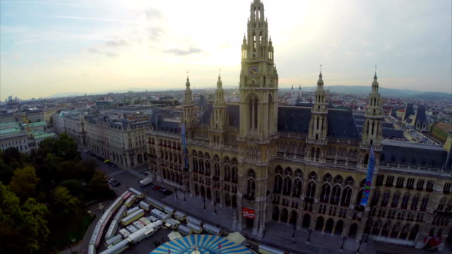 Vienna from above Rathaus mayor residence streets at dusk time. Beautiful aerial shot above Europe, culture and landscapes, camera pan dolly in the air. Drone flying above European land. Traveling sightseeing, tourist views of Austria. video