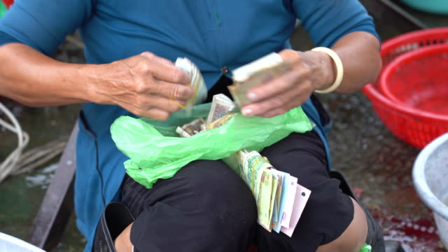 Vietnamese Marketers are counting the cash generated by selling products in the bazaar.