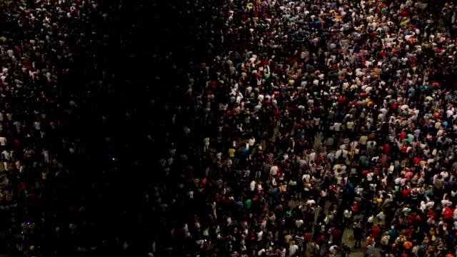 View above dancing crowd, spectators outdoor video