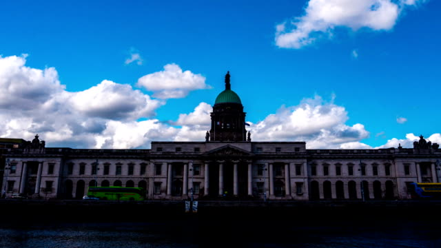 View across Liffey River on southern facade of Custom House in Dublin timelapse