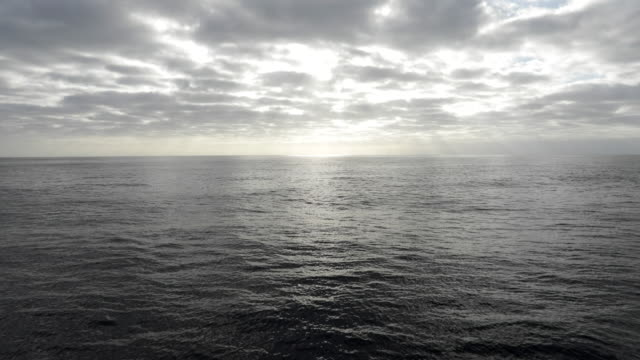View across open ocean from moving boat
