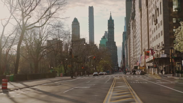 View along West 59th street nearby Central Park towards the Plaza Hotel. The city is deserted because of quarantine during the COVID-19 pandemic.