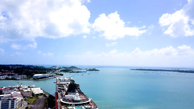 view around a cruise liner boat at quay in guadeloupe under the blue sky. we can see the city of saint francois near the bay. - cruise video stock e b–roll