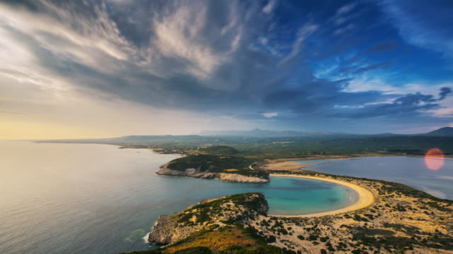 view at voidokilia beach from above. time lapse - пелопоннес стоковые видео и кадры b-roll