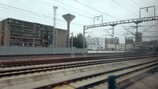 View form high-speed rail car,Sichuan,China. View form high-speed rail car,Sichuan,China. railroad station platform stock videos & royalty-free footage