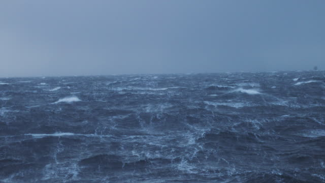View from a sailing boat of a rough stormy sea: in the ocean during a gale