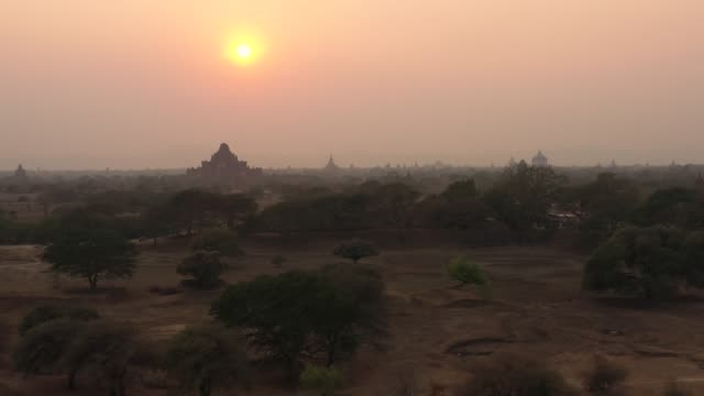 View from above, stunning aerial view of the beautiful Bagan Archaeological Zone (formerly Pagan) during sunset. Drone footage over hundreds of temples surrounded green rich vegetation, Myanmar. View from above, stunning aerial view of the beautiful Bagan Archaeological Zone (formerly Pagan) during sunset. Drone footage over hundreds of temples surrounded green rich vegetation, Myanmar. bagan stock videos & royalty-free footage